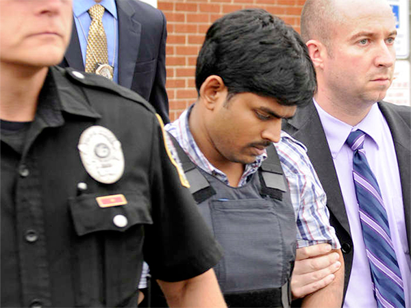 Raghunandan Yandamuri (center) has been charged in the deaths of a baby and her grandmother.