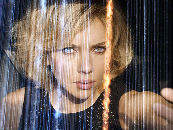 "Scarlett Johansson stars in ""Lucy,"" smuggling a new, high-tech designer drug into Taipei when the contraband accidentally seeps into her bloodstream, turning her into a super-powered, super-brainy fighting machine. (Universal Pictures)"