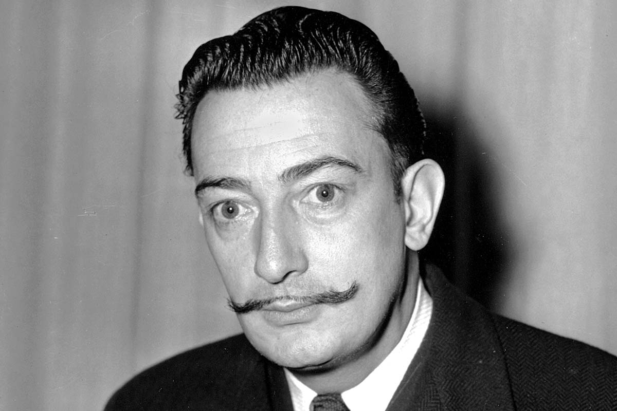 FILE - In this file photo taken on Nov. 4, 1942 Spanish surrealist painter, Salvador Dali is pictured in New York.   Dali´s eccentric artistic and personal history took yet another bizarre turn Thursday, July 20, 2017,  with the exhumation of his embalmed remains in order to find genetic samples that could settle whether one of the founding figures of surrealism fathered a girl decades ago. (AP Photo, File)