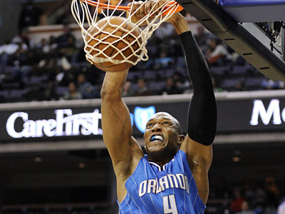 Center Tony Battie, seen here playing with the Orlando Magic, has signed with the Sixers. (AP Photo/Nick Wass)