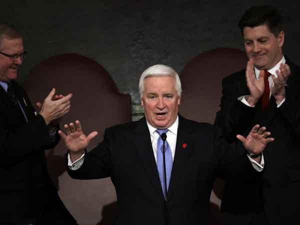 Gov. Tom Corbett gestures as he is applauded at a joint session of the Pennsylvania House and Senate on Tuesday, Feb. 5, 2013, in Harrisburg, Pa. during the state budget address.   Pennsylvania Lt. Gov. Jim Cawley is seen on right, and Speaker of the Pennsylvania House of Representatives, Rep. Sam Smith, R-Jefferson, is seen on left. (AP Photo/Matt Rourke)