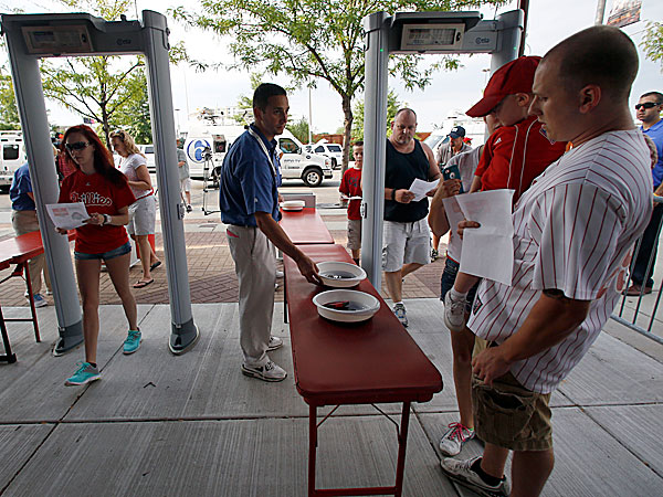 Fans enter Citizens Bank Park through metal detectors at the right field entrance. (Yong Kim/Staff Photographer)