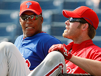 Milt Thompson, left, was fired by the Phillies Thursday night. He was the Phillies hitting coach since 2007.  (AP File Photo / Kathy Willens)