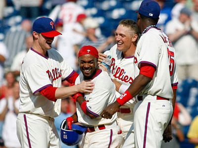 Jimmy Rollins celebrates teammates after his game-winning hit. (AP Photo/H. Rumph Jr)
