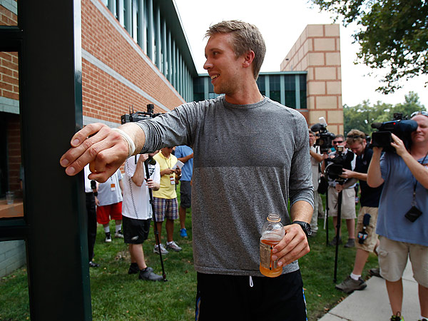 Eagles quarterback Nick Foles outside the NovaCare complex on the first day of training camp. (David Maialetti/Staff Photographer)