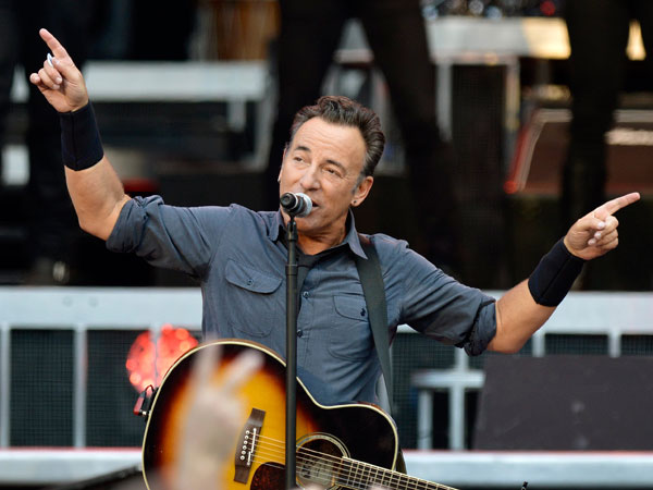 In this picture made available Thursday, July 4, 2013, U.S singer Bruce Springsteen & The E Street Band perform during a concert at the Stade de Geneve stadium in Geneva, Switzerland, Wednesday, July 3, 2013. (AP Photo/Keystone, Martial Trezzini)