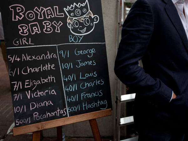 Some people are putting money on what they think Prince William and his wife, Kate, will call their baby, due soon. Near London´s St. Mary´s Hospital, a betting firm lists odds for select names. (Associated Press)