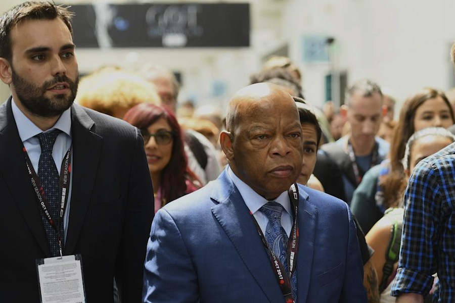 "From left, Andrew Aydin, Rep. John Lewis, D-Ga., and Nate Powell participate in a demonstration following a panel for ""MARCH"" on day three of Comic-Con International on Saturday, July 22, 2017, in San Diego."