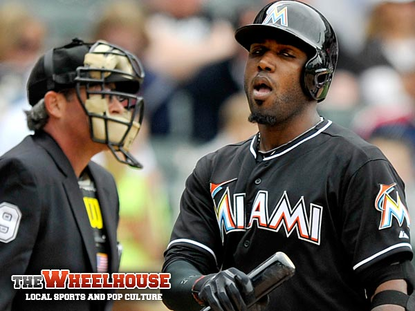Miami Marlins´ Marcell Ozuna reacts after striking out during the eighth inning of an MLB baseball game against the Chicago White Sox in Chicago Sunday, May 26, 2013. Chicago won 5-3. (AP Photo/Paul Beaty)