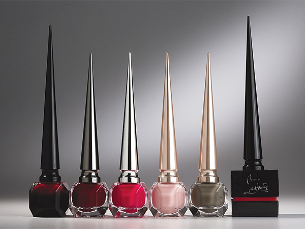 Rouge Louboutin (far left) is the first shade being released in Christian Louboutin´s new nail polish collection. (George Chinsee via Women´s Wear Daily)