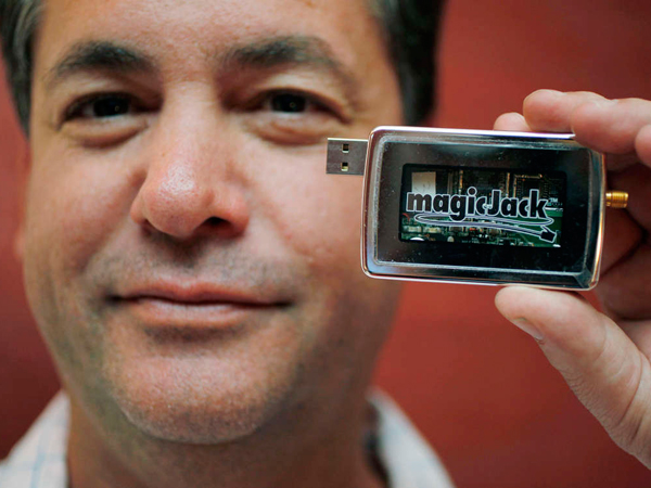 Dan Borislow with a MagicJack, which lets a computer double as a telephone. (AP, File)