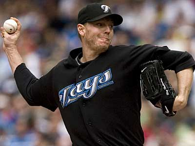 Toronto Blue Jays pitcher Roy Halladay delivers against the Boston Red Sox in Toronto, Sunday, July 19, 2009. (AP Photo/The Canadian Press, Darren Calabrese)