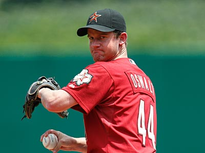 """The money part I can work out with anybody, that's no big deal,"" Roy Oswalt said. (AP Photo / Gene J. Puskar)"