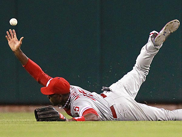 Phillies center fielder John Mayberry Jr. is unable to reach a three-run triple by the Cardinals´ Shane Robinson in the fifth inning. (Chris Lee/St. Louis Post-Dispatch/AP)
