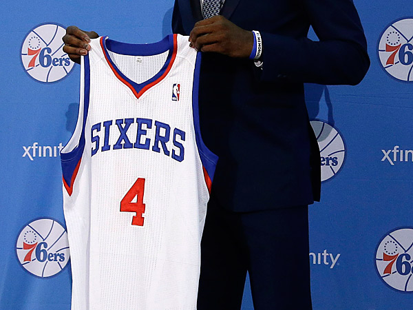 Philadelphia 76ers rookie Nerlens Noel holds up his new jersey. (AP Photo/Matt Rourke)