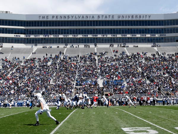 Penn State football players play at Beaver Stadium. (Keith Srakocic/AP)
