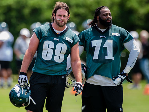 Evan Mathis (69) and Jason Peters (71) take a breather between drills during practice. (Matthew Hall/Staff Photographer)