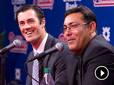 Ruben Amaro and Cole Hamels talk after signing a six-year, $144 million extension. (Ed Hille/Staff Photographer)