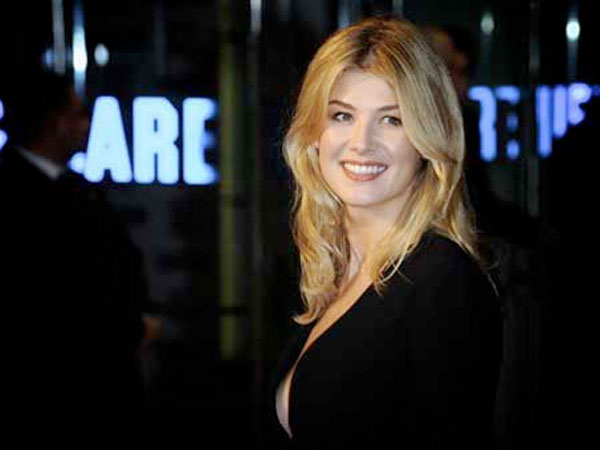 British actress Rosamund Pike arrives for the London Film Festival premiere of 127 HOURS, at a central London cinema, Thursday, Oct. 28, 2010.  The festival runs until Oct. 28, 2010. (AP Photo/Jorge Herrera)