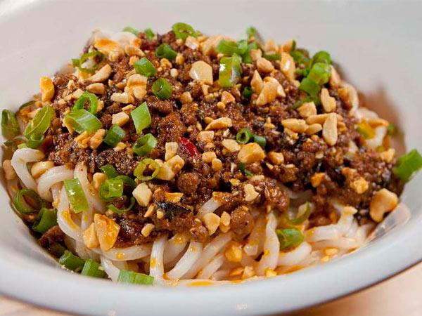 Dan Dan noodles with ground pork, zha cai, chile oil, and scallion, a ...