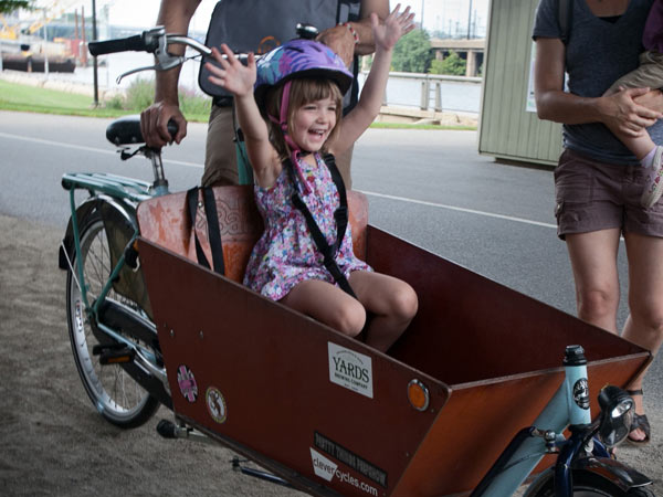 Frankie, 4, enjoys riding in a bakfiets on the Schuylkill River Trail. (Blake Larson)<br />