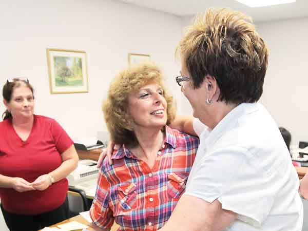Charlene Kurland, 69, center, gives her partner, Ellen Toplin, 60, right, a big hug after they received their official Marriage License from Second Deputy, Helene Sepulveda, left, in Norristown, PA. Recorder of Wills Office, 4th floor, One Montgomery Plaza, Norristown.  Two women have been married in a religious ceremony near Philadelphia after getting a same-sex license from county officials defying a state ban. They simply want to take advantage of the opportunity offered by Montgomery  07/24/2013 ( MICHAEL BRYANT / Staff Photographer  )