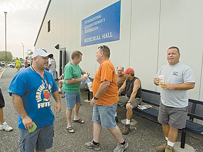 The mood is light - and so is the work - as longshorrmen gather at the union hall around 7 a.m. to see if they get a day of work on Thursday, July 16. ( Clem Murray / Staff Photographer )
