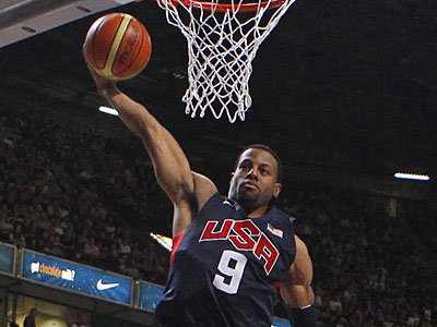 Andre Iguodala and his Olympic basketball teammates were mobbed in the Olympic Village. (AP Photo/Dave Thompson, PA)