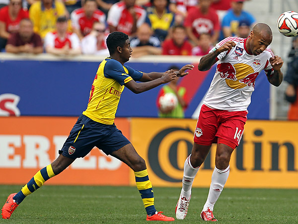 Gedion Zelalem (left) pursues Red Bulls star and former Arsenal legend Thierry Henry during Saturday´s game at Red Bull Arena. (Adam Hunger/AP)
