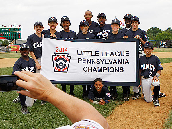 Taney poses for photos after winning the Pennsylvania State Little League Championship. (Michael S. Wirtz/Staff Photographer)