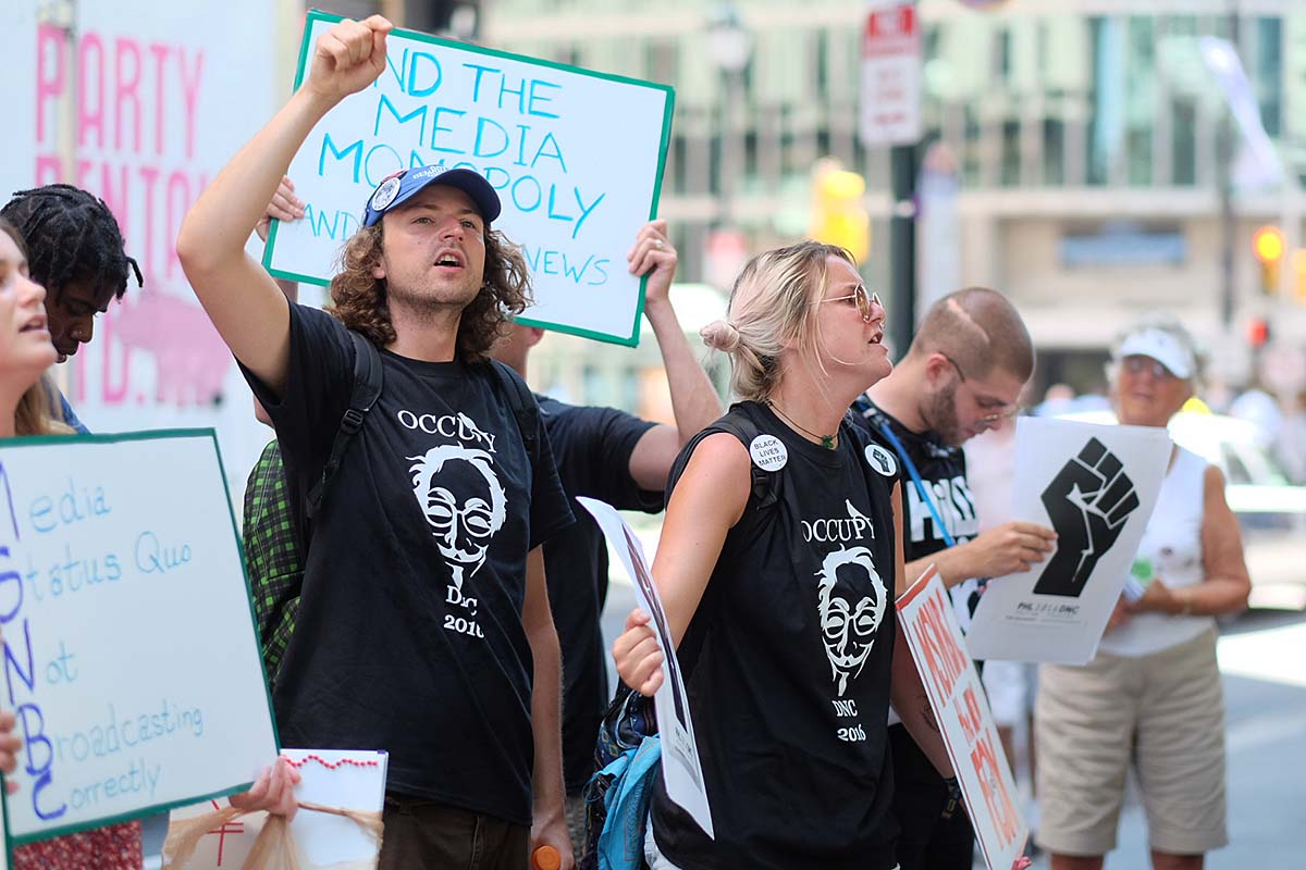 Protesters with Occupy DNC demonstrate outside Comcast´s Center City headquarters.
