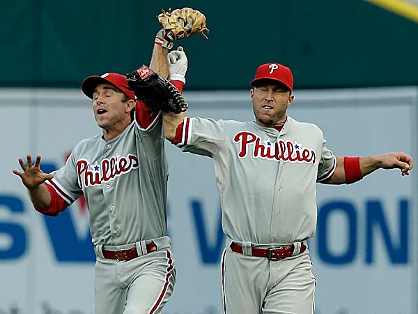 The Phillies´ Chase Utley and Laynce Nix. (Carlos Osorio/AP)