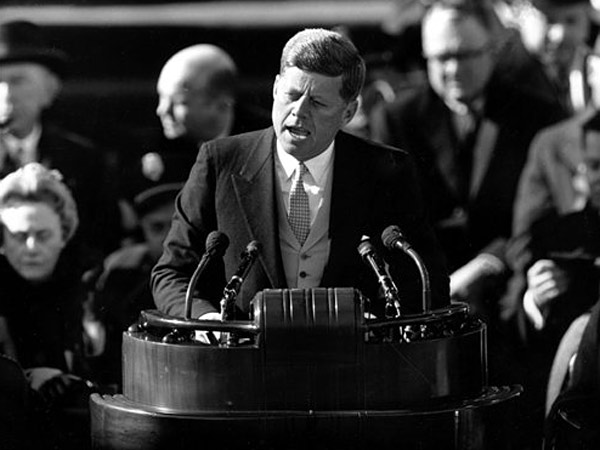 FILE - This Jan. 20, 1961 black-and-white file photo shows President John F. Kennedy delivering his inaugural address after taking the oath of office, on Capitol Hill in Washington. (AP Photo, File)