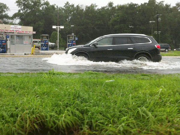 "Late-day flash floods hit Camden, Bellmawr and Paulsboro leading to sporadic road closures, according to police dispatchers and scanner reports. In Gloucester City, a stretch of Route 130 under Route 295 was ""completely flooded"" and had cars submerged, the Breaking News Network said. (Staff photo)"