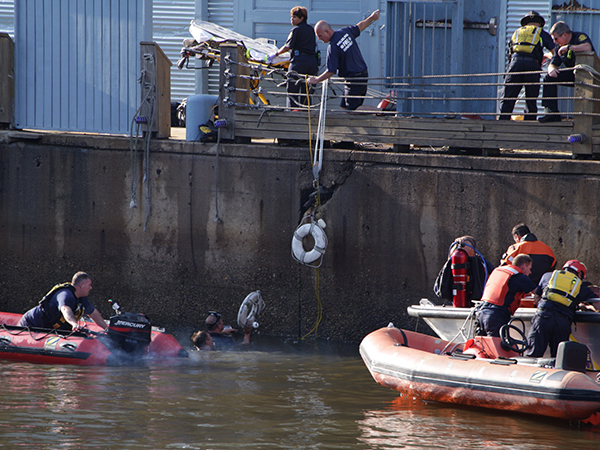 Divers in the Delaware River search for possible passengers in a car that plunged into the water.