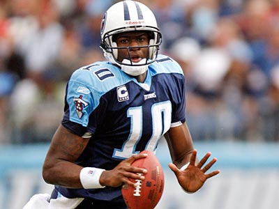 Vince Young will report to training camp on Saturday. (Mark Humphrey/AP)