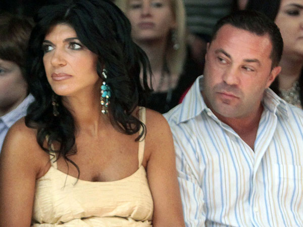 "FILE - This Sept. 13, 2009 file photo originally released by Oral-B Pulsonic shows ""Real Housewives of New Jersey"" stars, Teresa Giudice, left, and her husband Joe Giudice at the Caravan Fashion Show sponsored by Oral-B Pulsonic in New York. Teresa and Giuseppe ìJoeî Giudice were charged in a 39-count indictment handed up Monday, July 29, 2013,  in Newark, N.J. The two are accused of submitting fraudulent mortgage and other loan applications from 2001 through 2008, a year before their show debuted on Bravo. Prosecutors say they made false claims about their employment status and salaries. (AP Photo/Oral-B Pulsonic, Gary He)"