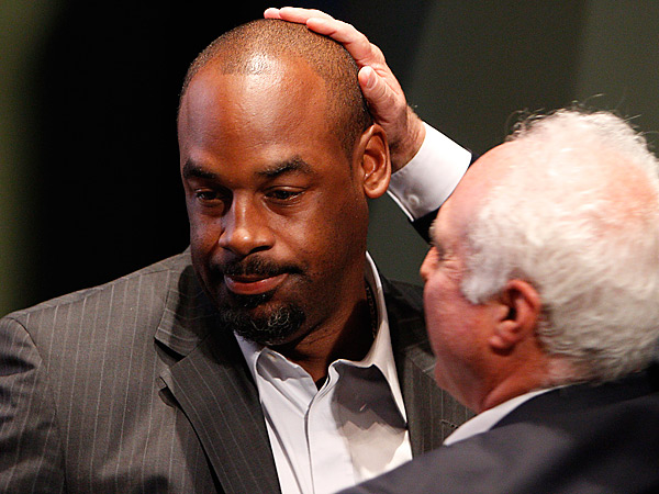 Eagles owner Jeffrey Lurie pats Donovan McNabb as he officially retires as an Eagle.