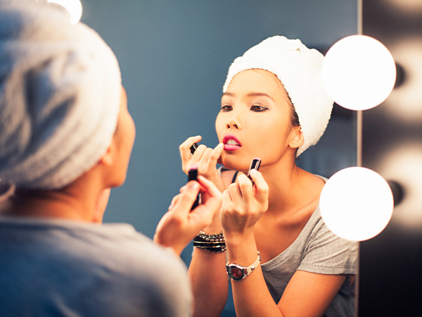 Lipstick has been helping save face (literally) for forever and is often the perfect pop of color for an otherwise understated ensemble. (iStock)