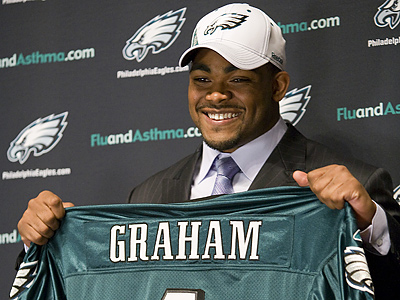 Brandon Graham is scheduled to arrive at training camp today. (AP Photo/Mark Stehle)