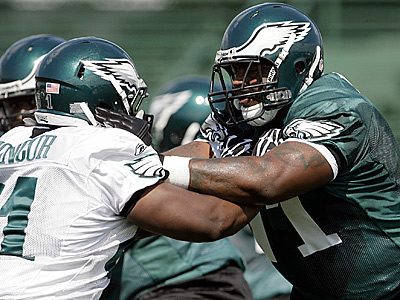 Eagles´ Jason Peters (right) blocks Eric Moncur, a rookie out of Miami during afternoon training camp on Friday.  (Yong Kim/Staff Photographer)