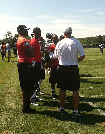 Vince Young, in visor, confers with QBs