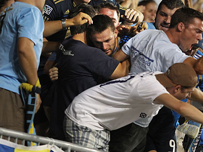 Jack McInerney celebrates with Union fans after scoring the winning goal. (Ron Cortes/Staff Photographer)