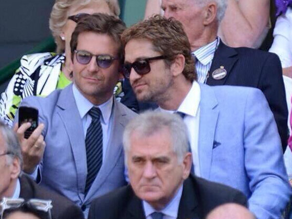 TV cameras caught Bradley Cooper and Gerard Butler snapping a selfie during the Men´s singles final at Wimbledon.