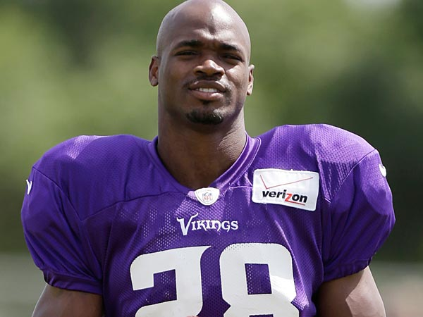 Minnesota Vikings running back Adrian Peterson walks on the field during NFL football training camp, Monday, July 29, 2013, in Mankato, Minn. (AP Photo/Charlie Neibergall)