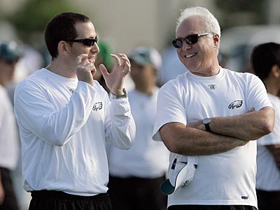 Jeffrey Lurie (right) and Howie Roseman watch today´s practice. (Yong Kim / Staff Photographer)