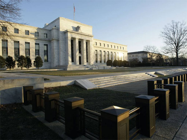 FILE - This Jab. 14, 2010 file photo shows the Federal Reserve Building in Washington. (AP Photo / Alex Brandon, File)