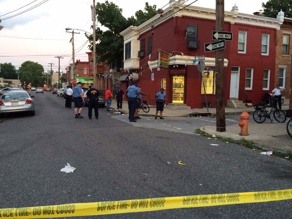 One man is dead, and two more wounded, after a violent confrontation outside a corner store  on Hicks Street near Bristol, police said. (Photo: Vinny Vella / Staff)