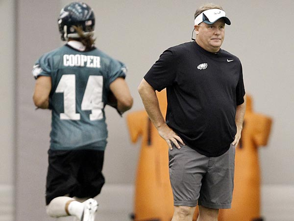 Eagles receiver Riley Cooper runs behind head coach Chip Kelly during a training camp practice on Thursday, August 1. (David Maialetti/Staff Photographer)