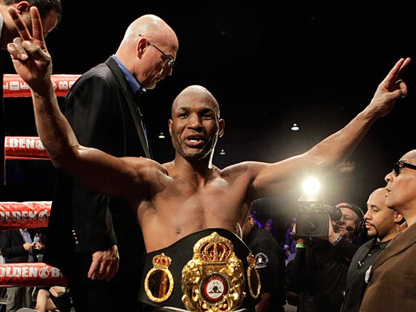 Bernard Hopkins, of the United States, leaves the ring after defeating Beibut Shumenov, of Kazakhstan, by a split decision after their IBF, WBA and IBA Light Heavyweight World Championship unification boxing match, Sunday, April 20, 2014, in Washington. Hopkins won by a split decision. (Luis M. Alvarez/AP)